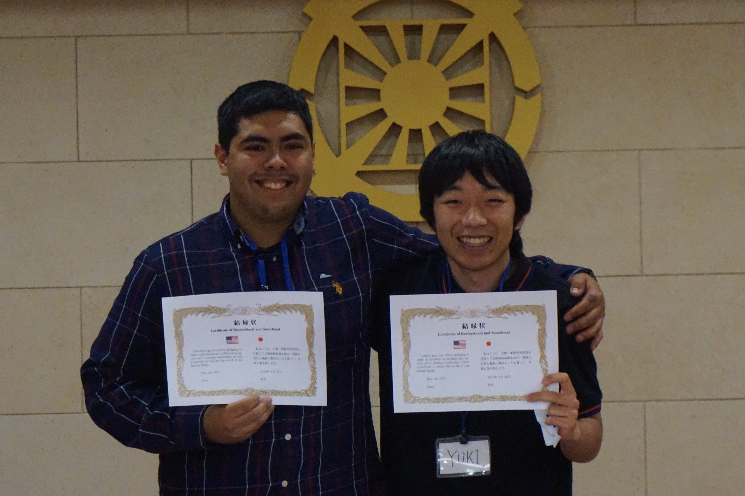 In the Brotherhood Ceremony, a Japanese and an American CARP member are united.