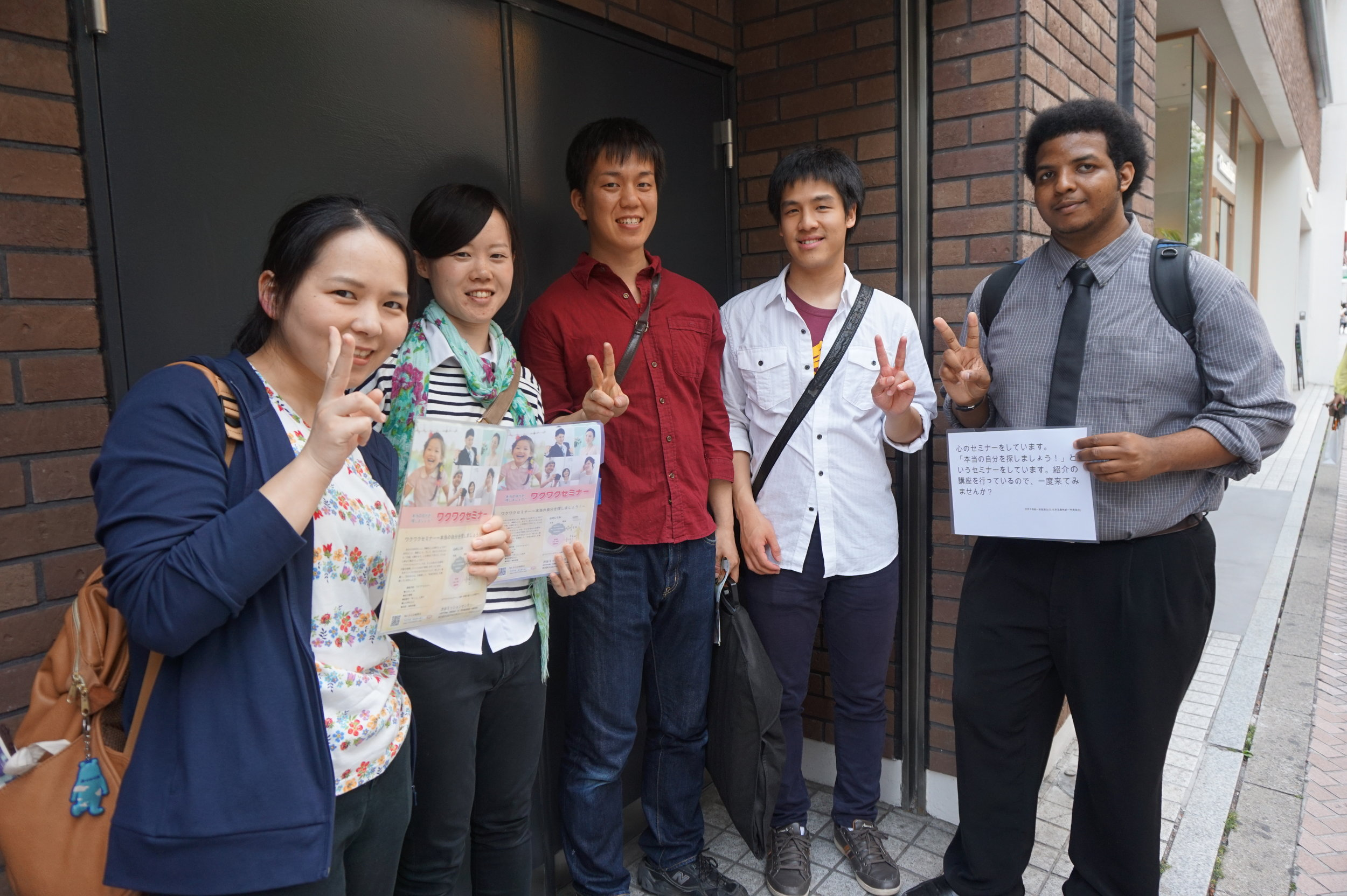 American and Japanese students doing outreach in the local area.
