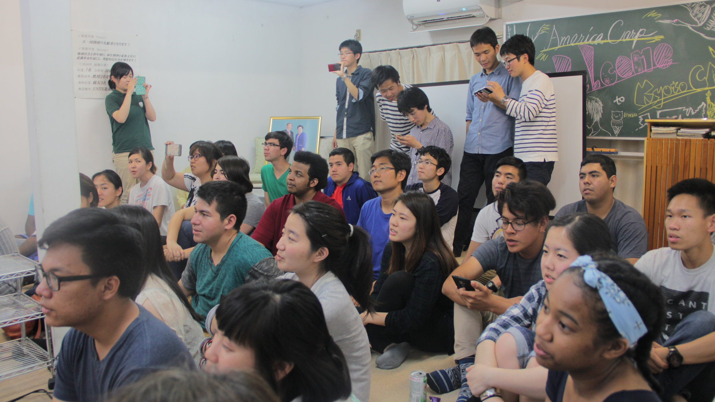 Students gathered at the CARP center by Kyoto University.