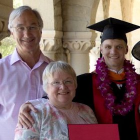 Marjorie and Richard beaming at their son's graduation .