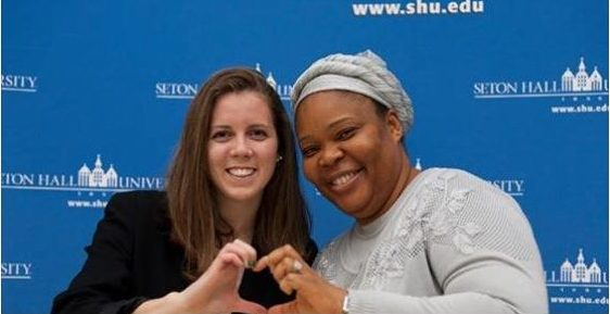 Here I am making a heart with Nobel Peace Prize winner, Leymah Gbowee, during a presentation at Seton Hall University.