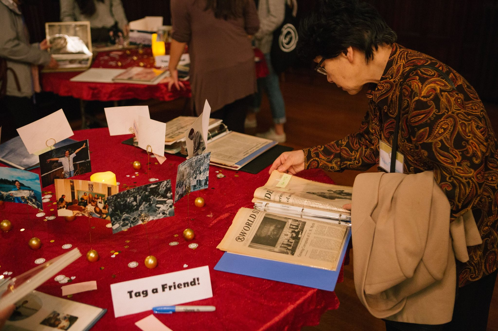 Reception of photos and literature celebrating CARP's rich 50 years.