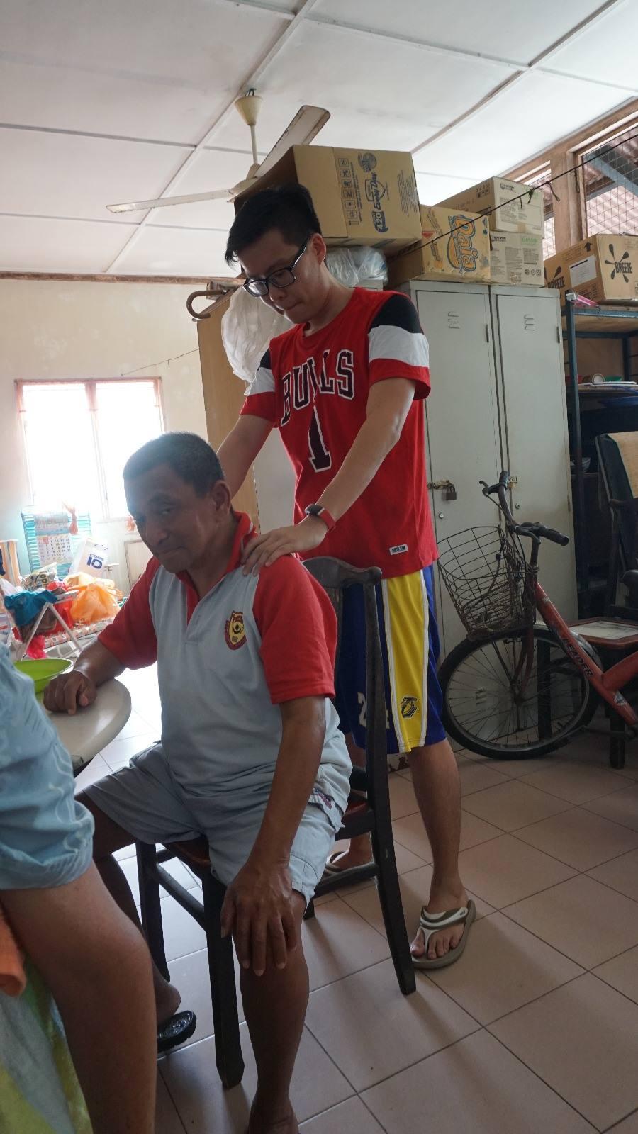 CARP member massaging an elderly person