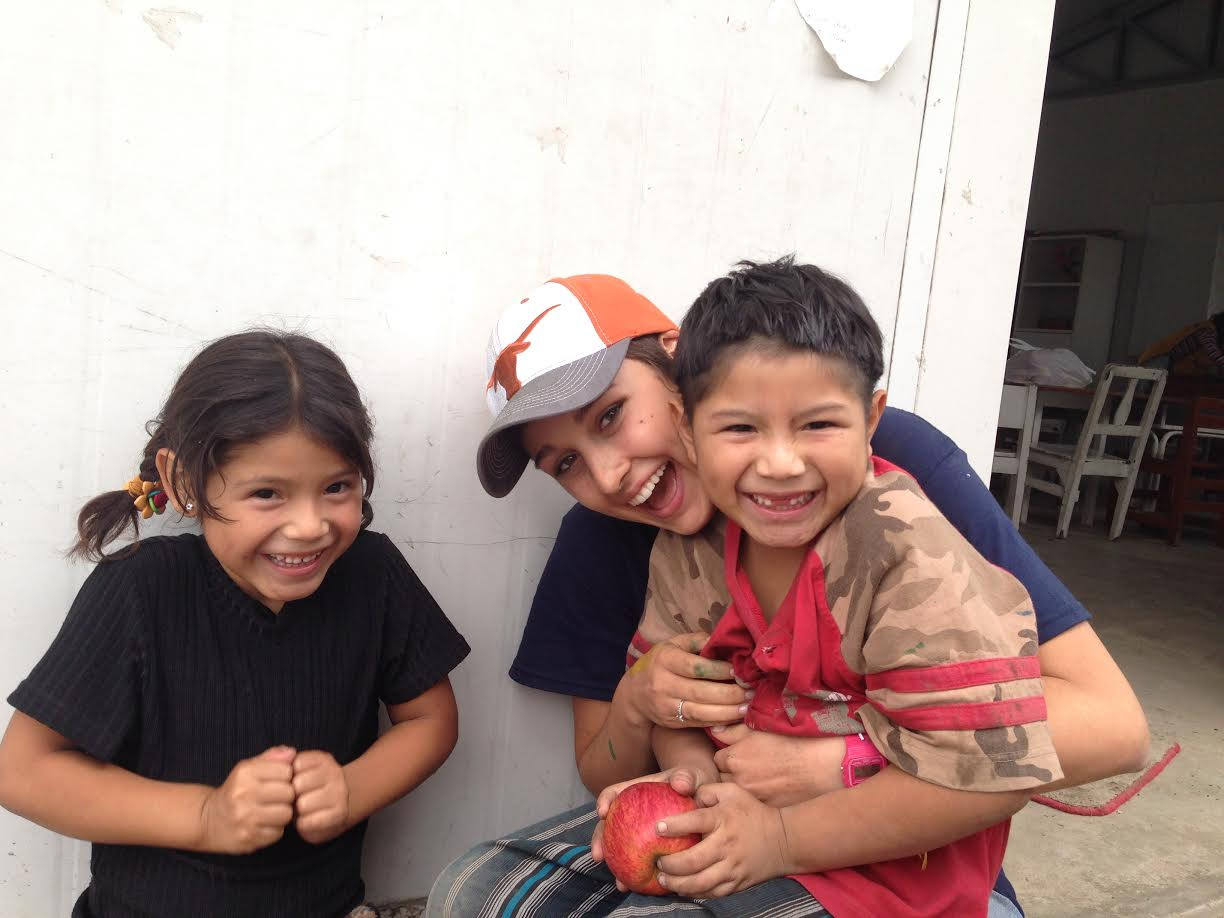 Kristin on a service trip to Peru helping to beautify a playground for the children of the community.