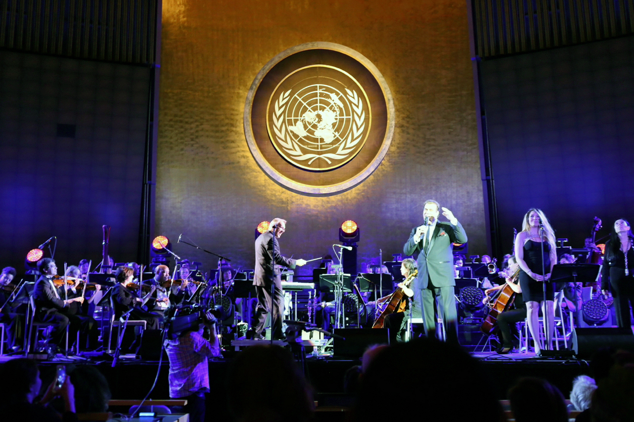 David Eaton performs with actor/singer Robert Davi and the New York City Symphony at the United Nations' 70th Anniversary concert on June 30, 2015.