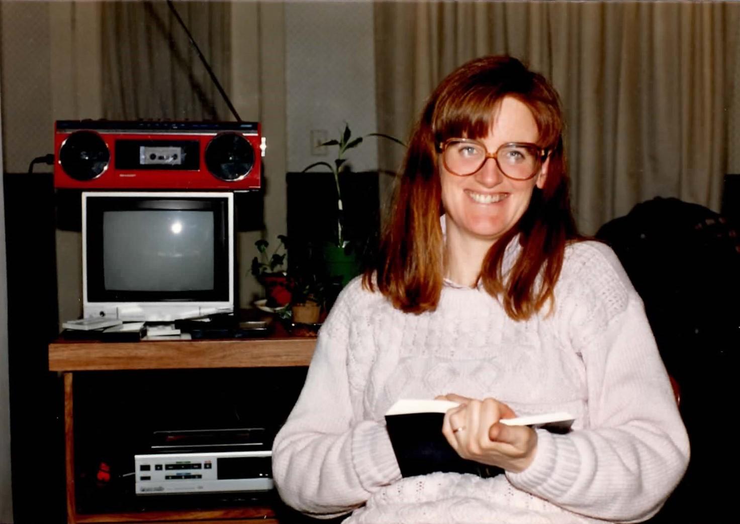 Christine preparing to speak to members in the 1980s.