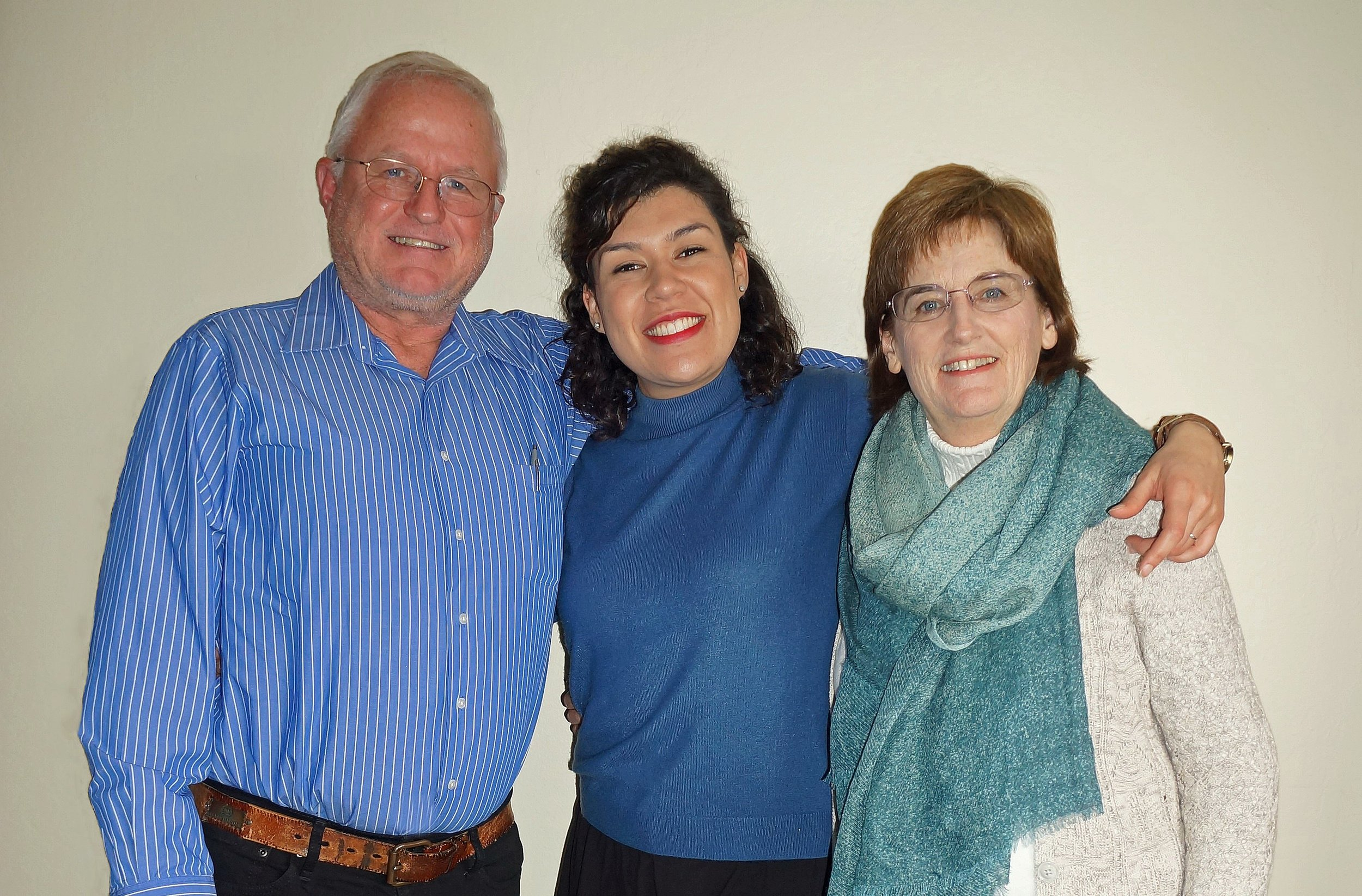 Christine with her husband and daughter.