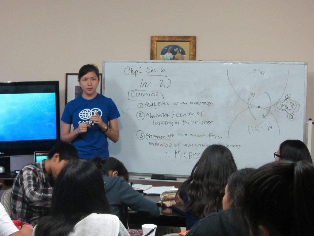 Jennifer Pierce sharing Unification Principles to high school participants.