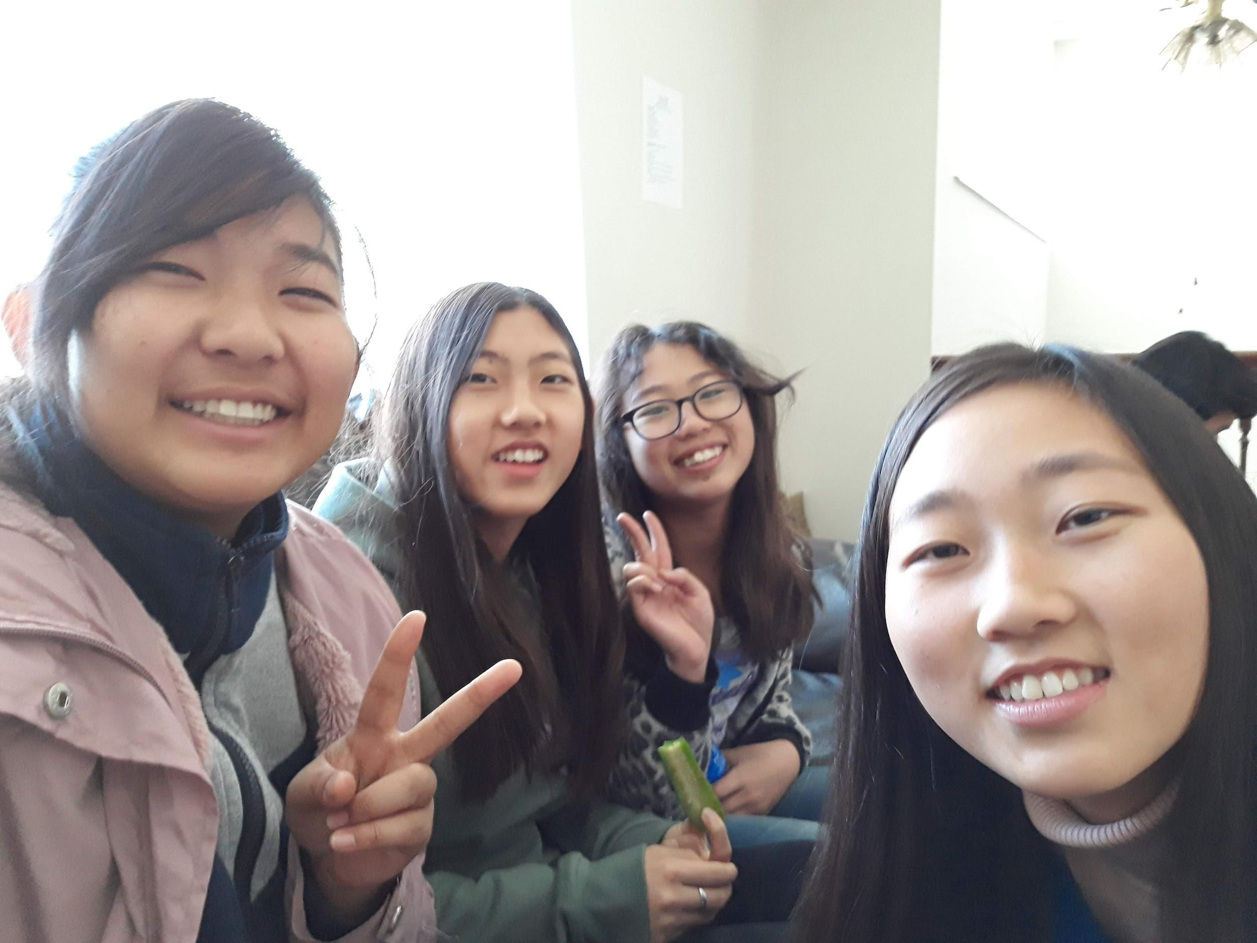 Kana Ishii (left front)  and Yeon-su Hwang (right front) return from their gap year program for winter break to join the retreat.
