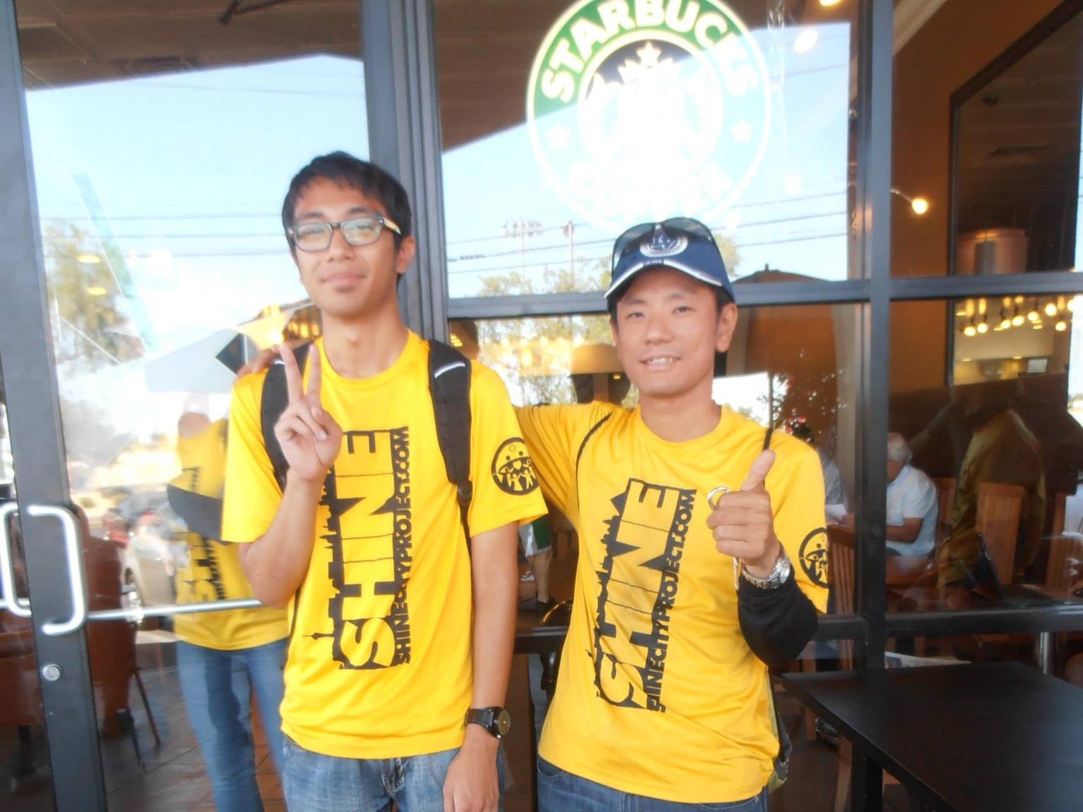 After a clean-up, Jeffrey (left) and Satoshi Inoue (right) take a final photo before Satoshi returns to Japan.