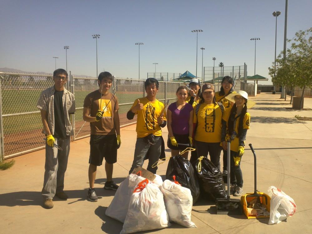 Jeffrey's first Shine City Project service project at Lorenzi Park with volunteers. Satoshi stands third from the left.