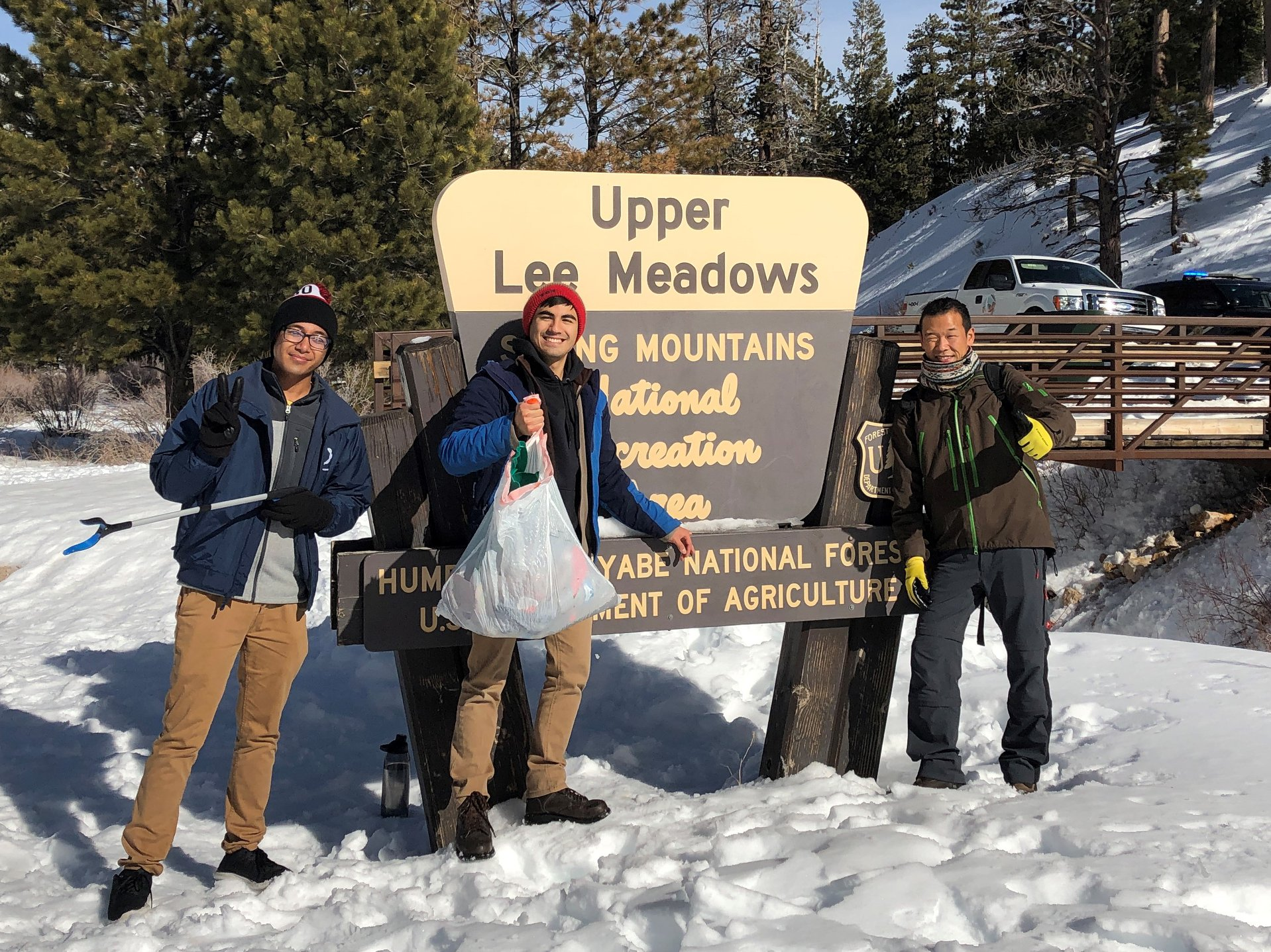 Snow doesn't deter these determined volunteers. Taken at Mount Charleston National Park.