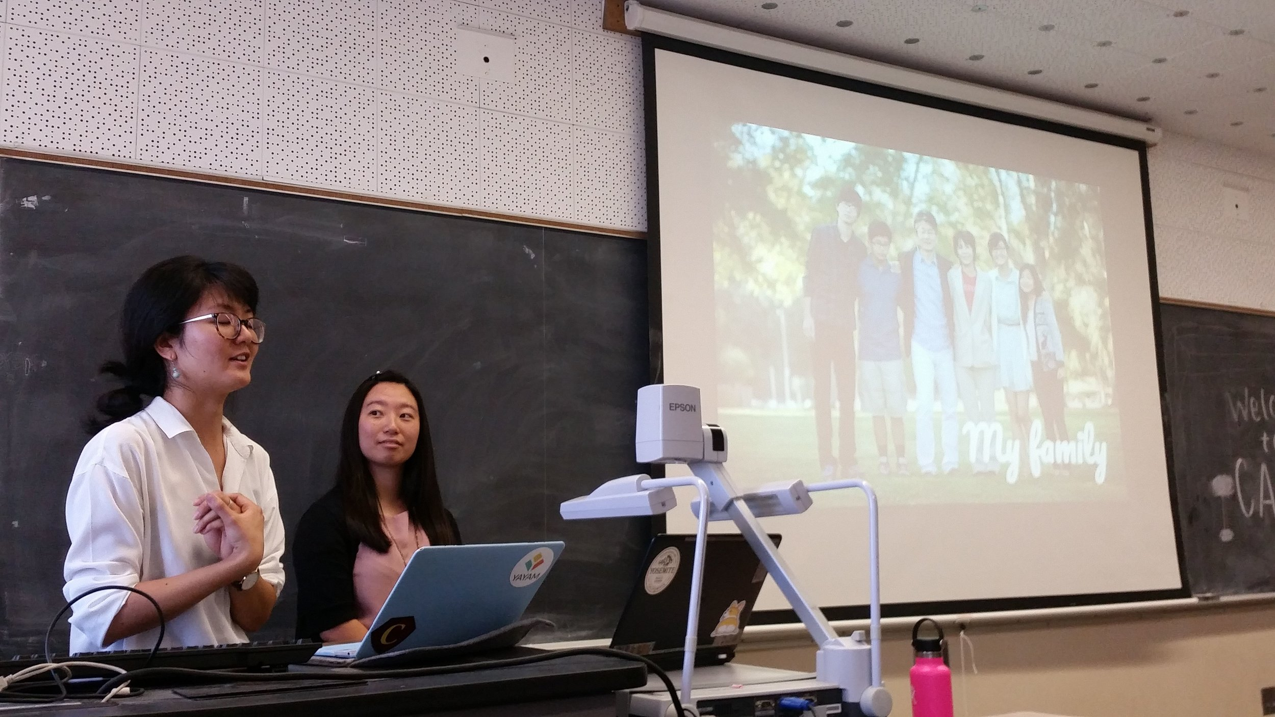 Satomi gives a CARP talk during a meeting.