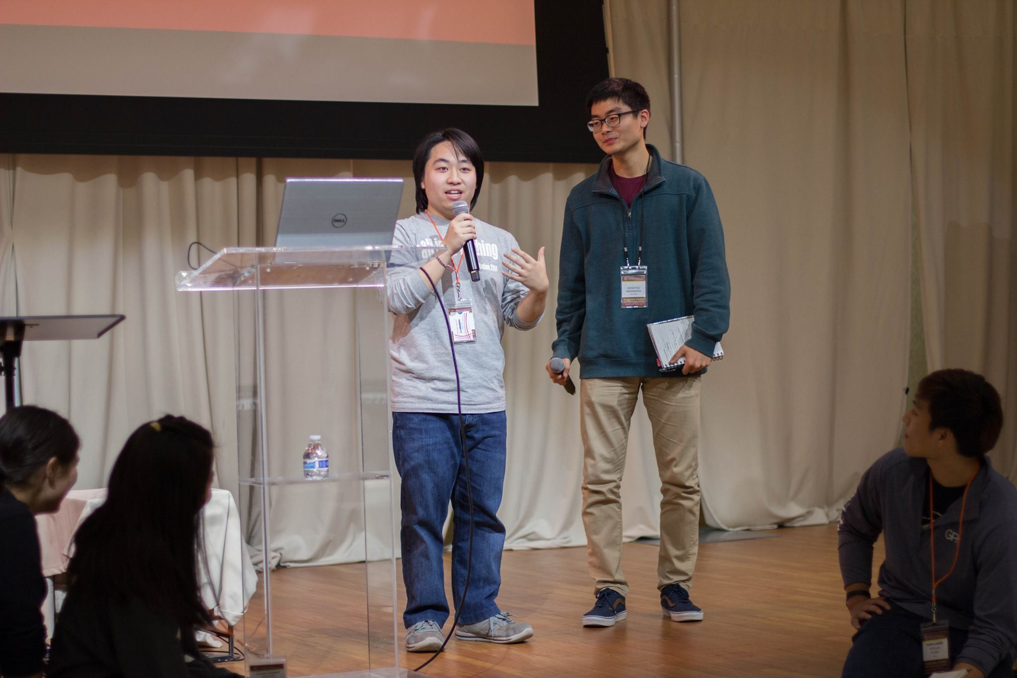 Takafumi (left) and his (then) Vice President, Keisetsu Nakamura (right), give a presentation on the activities at CARP NJIT.