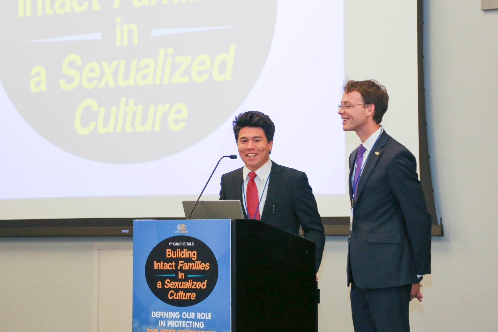 Emcees, Chungbom Katayama (left) and Jinil Fleischman (right), welcome everyone to the conference.