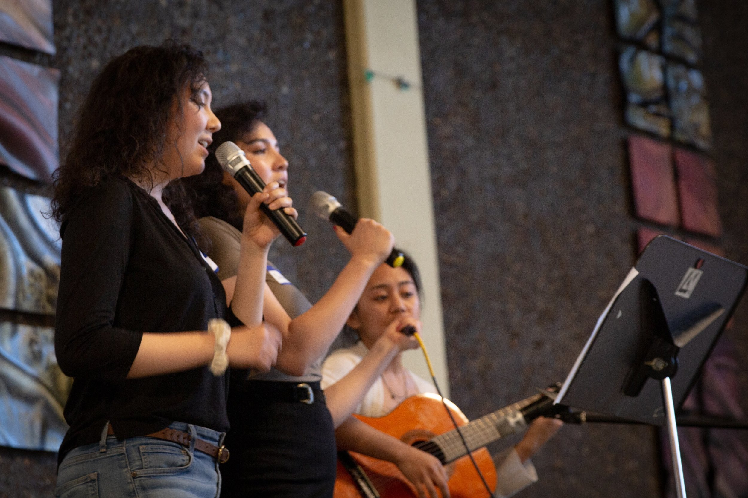 Amaris Durst (front), Sasha Durst (middle), and Geryln Quilates (back) sing for the crowd.