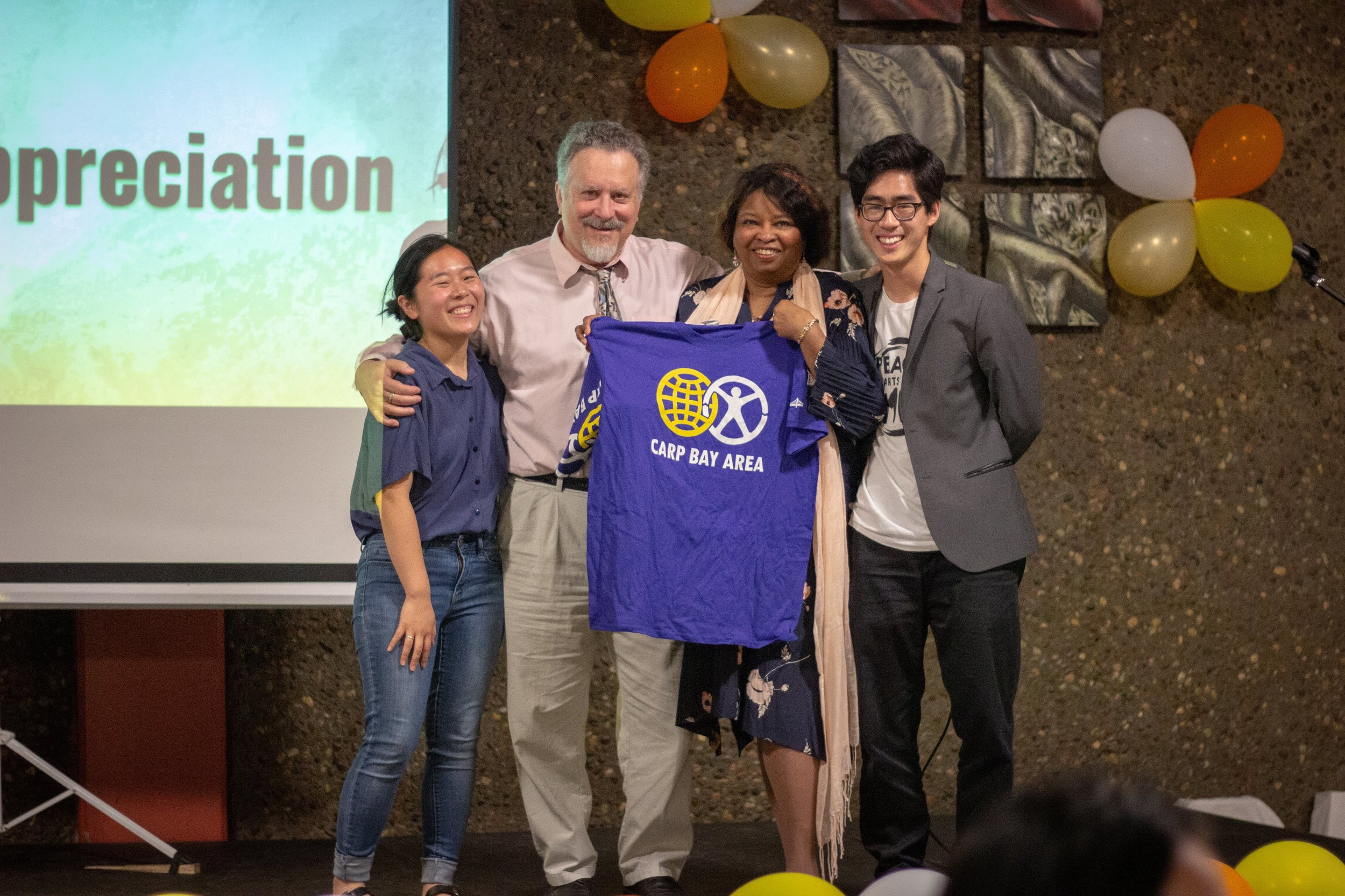 As a token of appreciation, CARP also presented t-shirts to Dr. Lowen (middle right) and her husband (middle left).