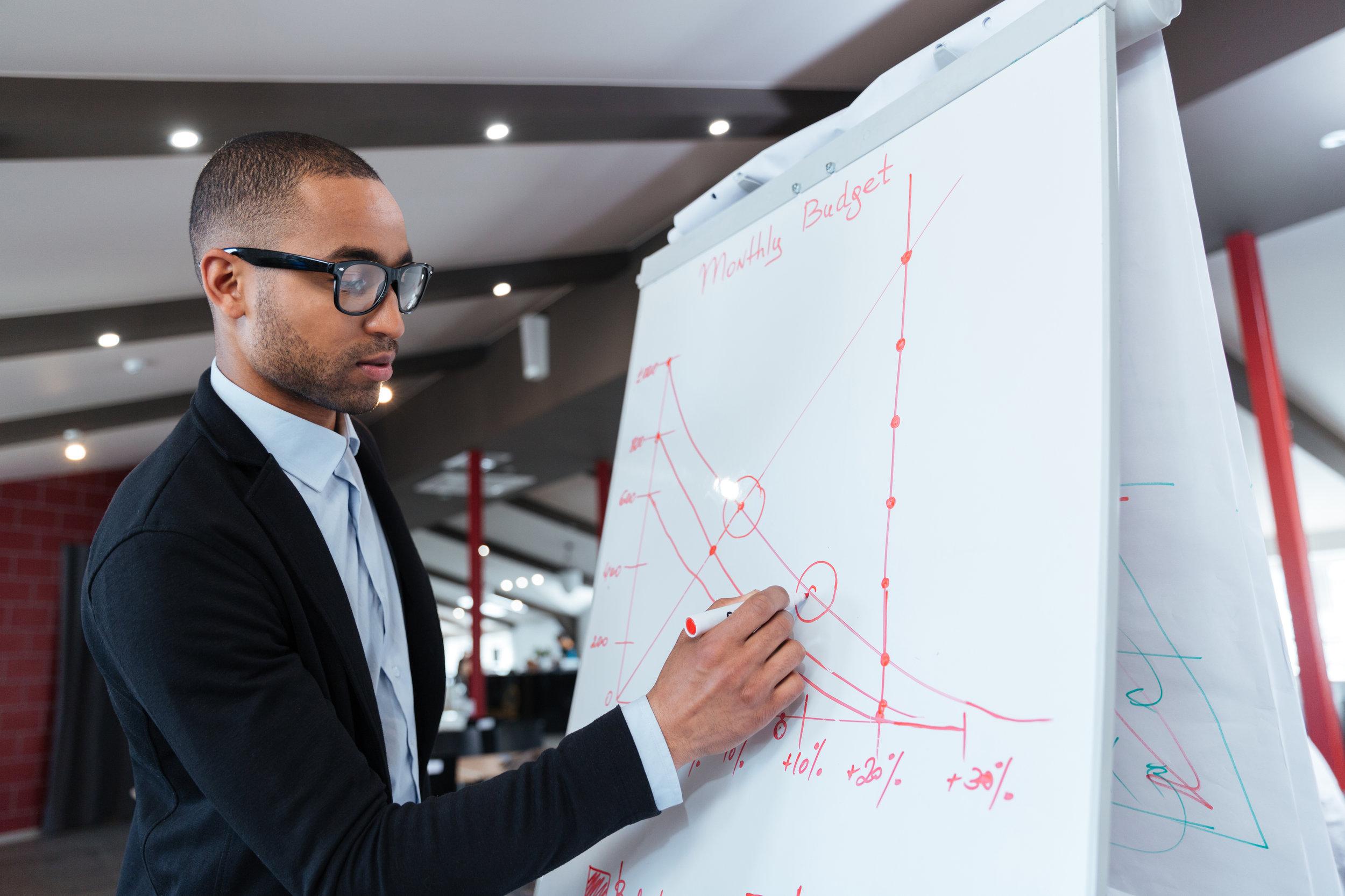 businessman-making-presentation-on-the-flipchart-PV4TGXX.jpg