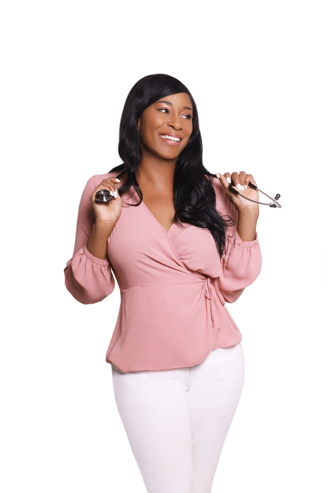 African-American woman in pink blouse and white pants with stethoscope, white background.jpg