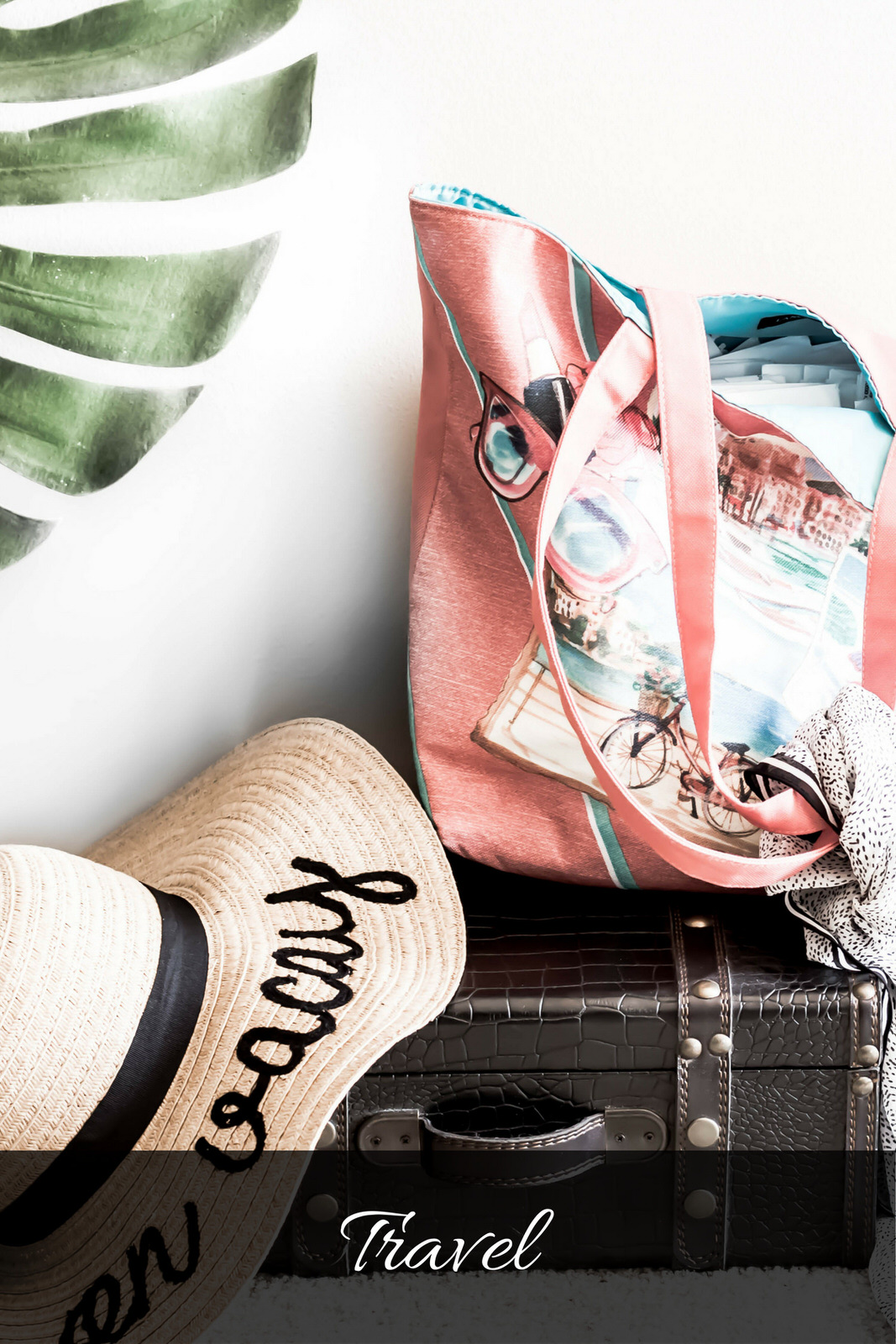 Travel suitcase with tote and straw hat and banana leaf.jpg