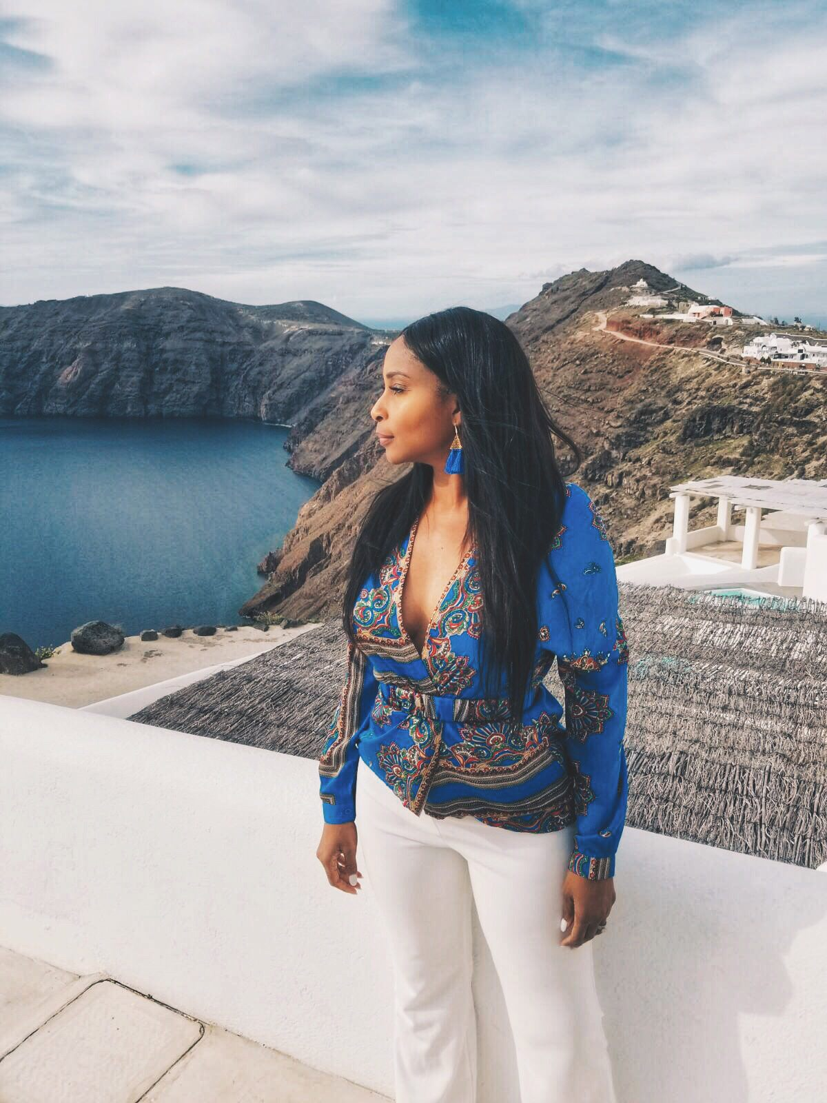 African-American Woman in Blue Blouse and White pants in Greece.JPG