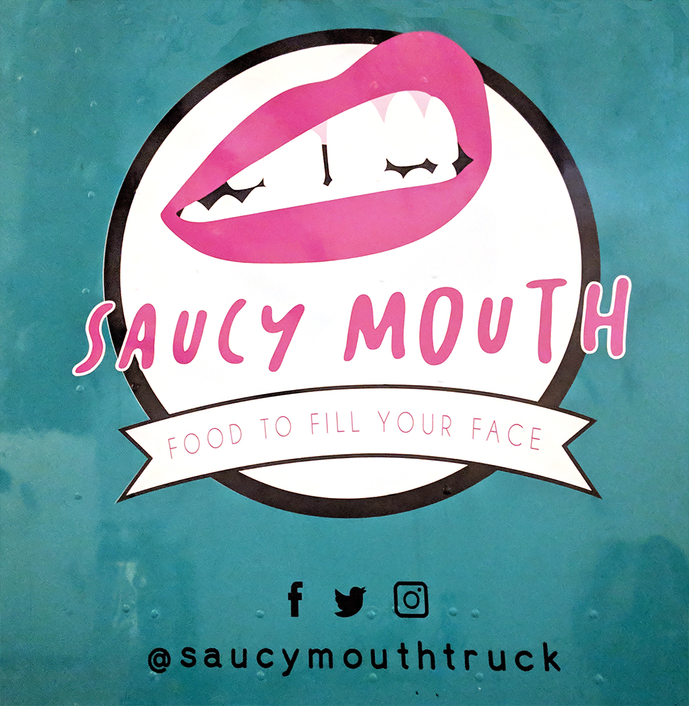 saucy mouth logo on truck - smaller.jpg
