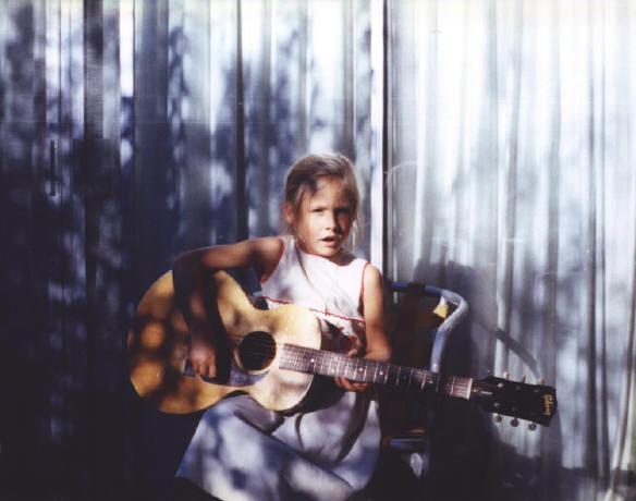 Sari at 7 playing Eric Clapton's Guitar