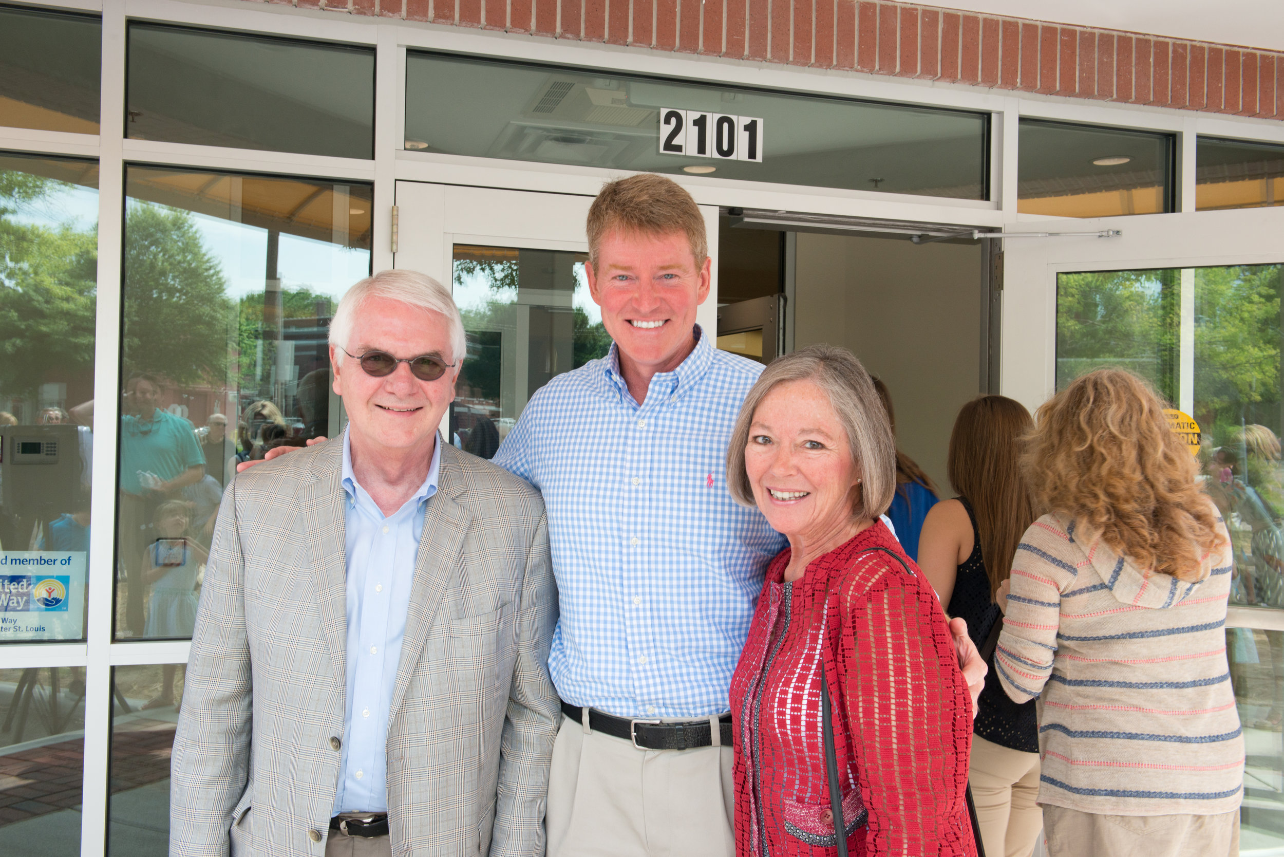 Tom and Carol Voss, honorary capital campaign chairs, with Attorney General Chris Kostner (center) at the grand opening celebration
