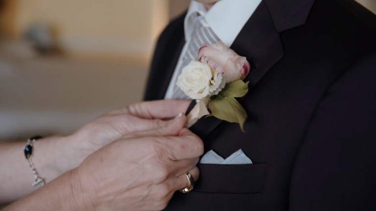 And Matthew's mother helps him with his lapel.
