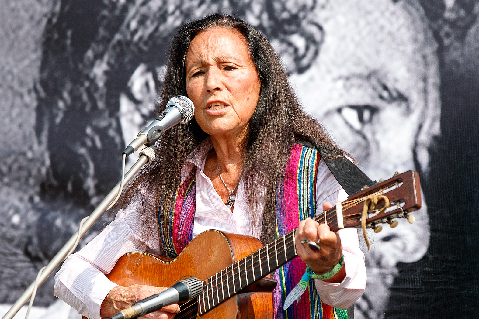 Incredible: Julie Felix plays against a vintage backdrop of Dylan on the 1969 Festival site in Wootton, IoW, on Tuesday, 27/8/19.