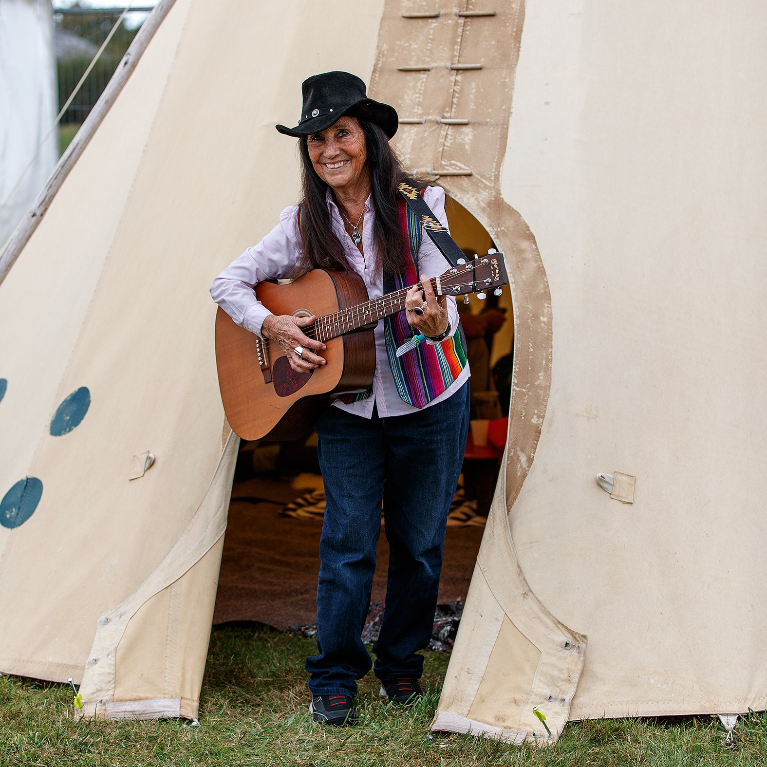 Julie Felix emerges from the backstage tepee. Photo: Dave Cramp.