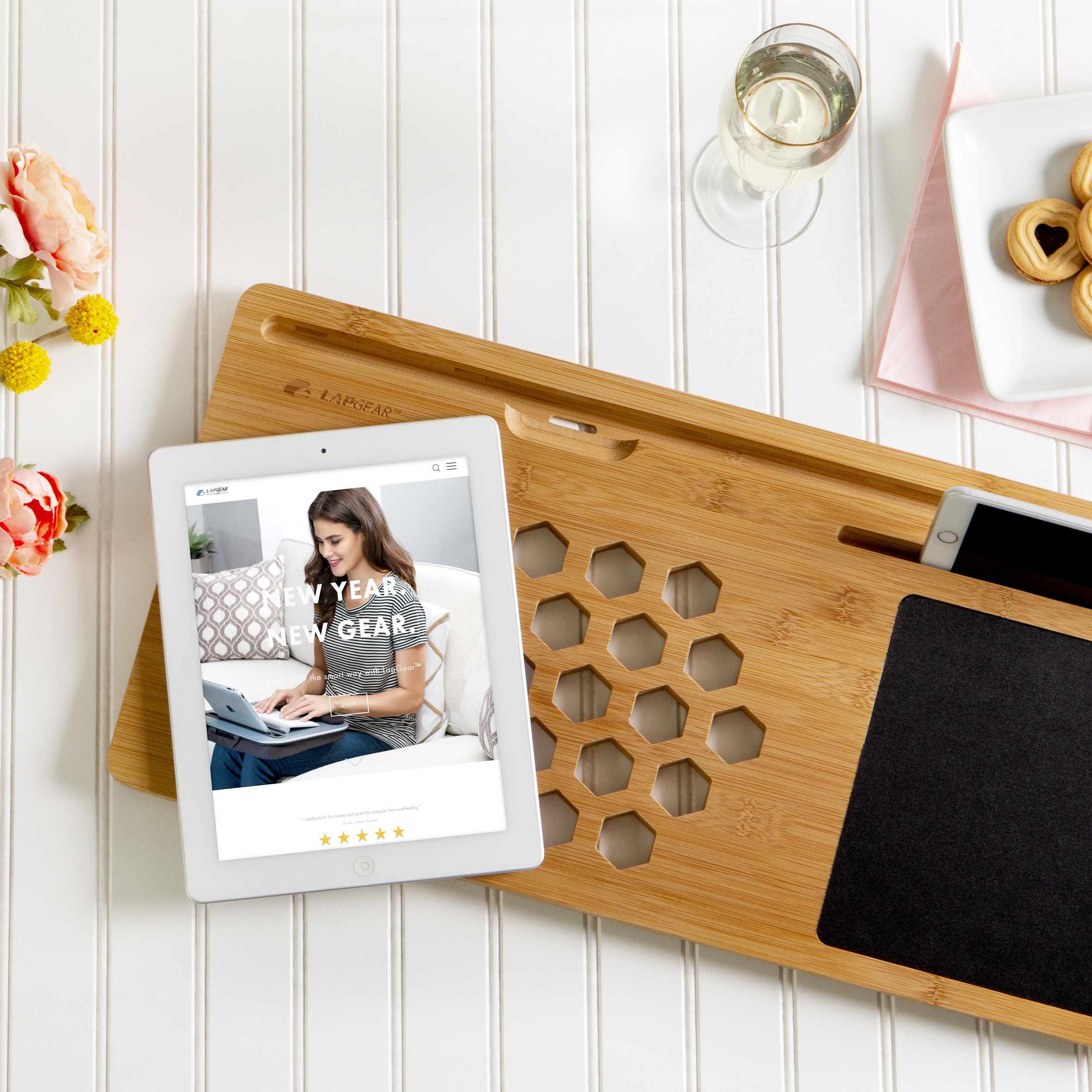 """BAMBOARD   $29.99   FITS LAPTOPS UP TO 15"""":  22"""" x 11""""   MEDIA SLOTS : Fits tablets up to 13"""" and cell phones up to 7.9""""   STYLE : Made from natural bamboo (a renewable resource)   IMPROVED AIR-FLOW : 29 ventilation holes allow for proper laptop ventilation, as recommended by laptop manufacturers."""