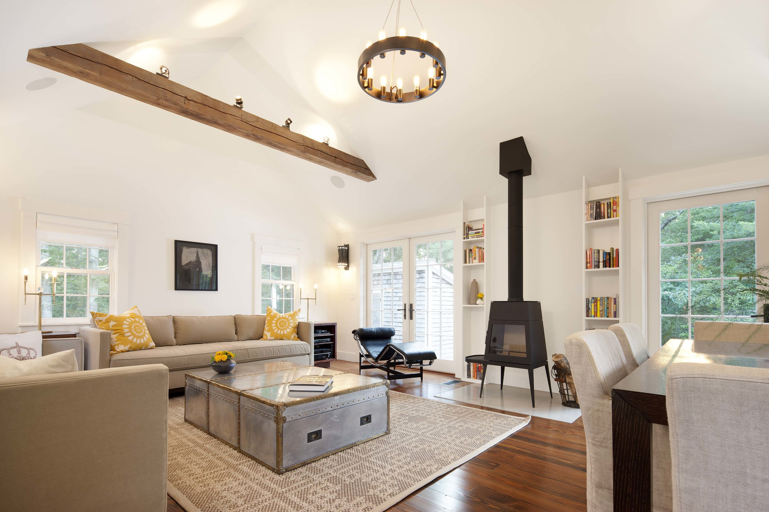 Living/dining space with contemporary wood stove.