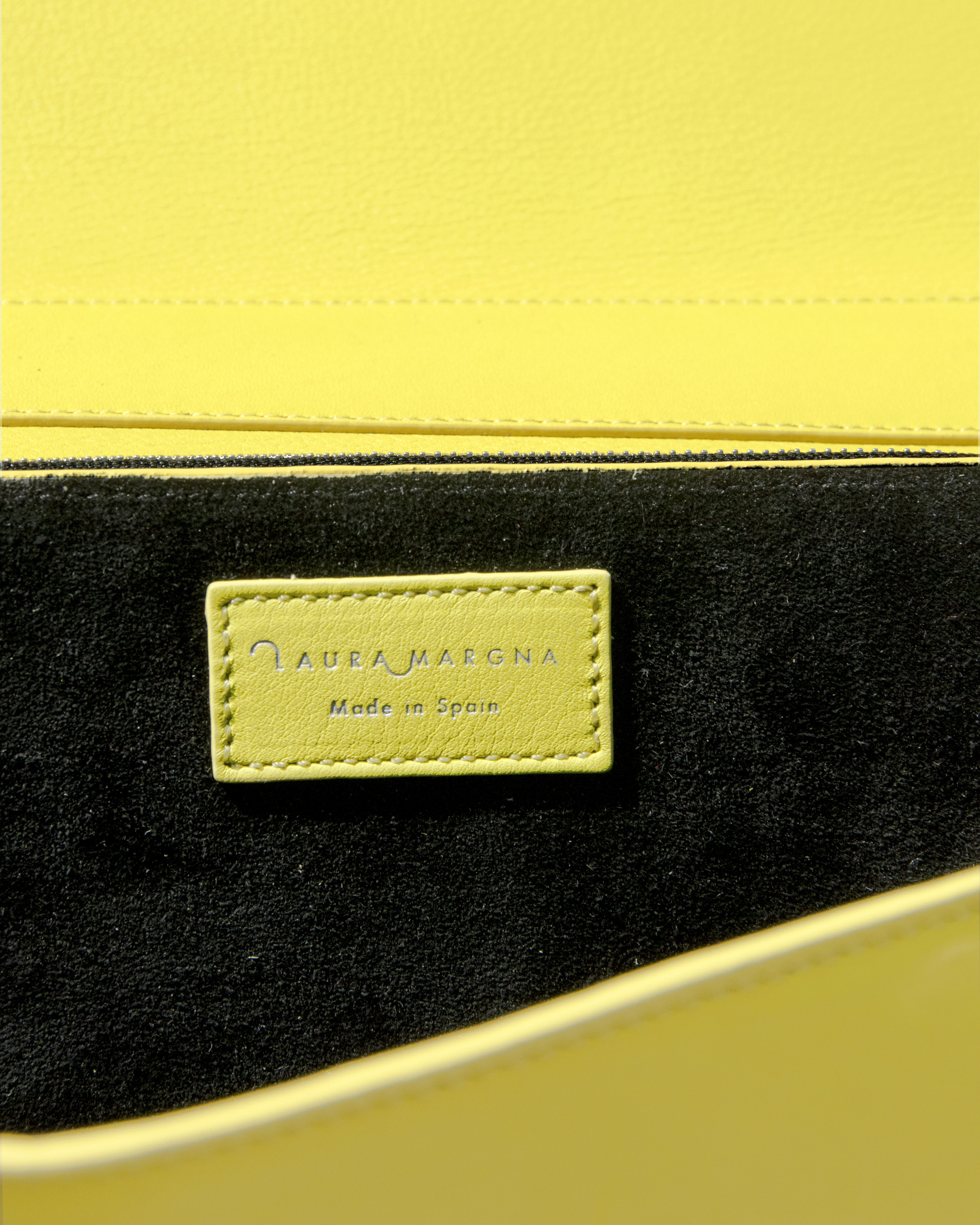 PROUDLY MADE IN SPAIN - • Quality ProductsWhile all of our designs are imagined in our small workshop in Zurich, we are very involved in the production process at our Spanish factory in Ubrique. We proudly stand behind the quality of each and every leather accessory. • Ethical ManufacturingBy producing our pieces in Europe, we ensure that each person, from the sewing team to the packers, is treated fairly.• Job CreationWith each product made, we contribute to local job creation in Ubrique as well as the continuation of traditional leather handiwork, a key pillar of the economy and culture in the village.