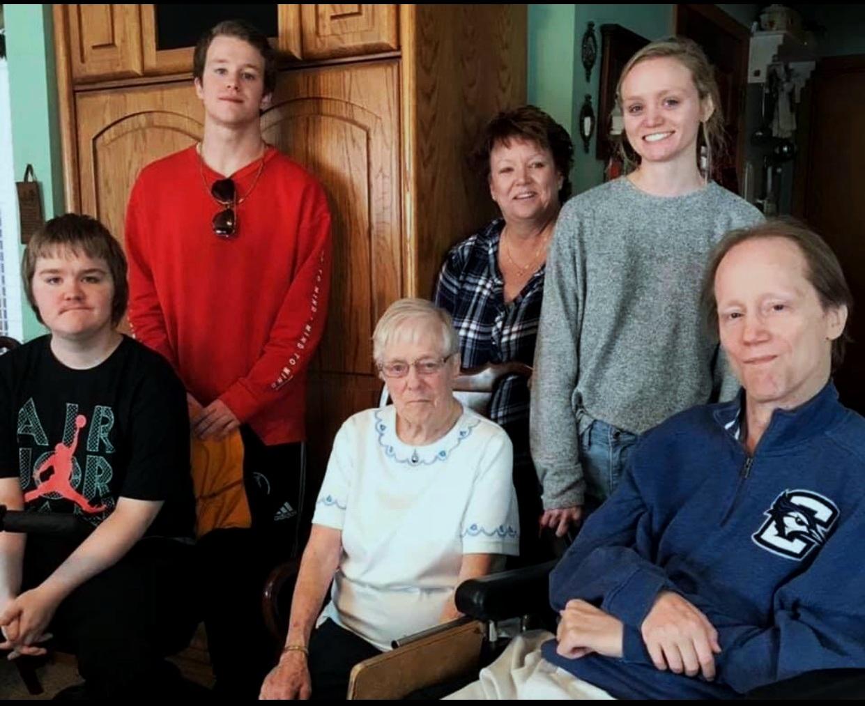 Wilson Family: Bruce (front right), Hannah (back right), Kelly (back center), Sam (back left), and Luke (front left)