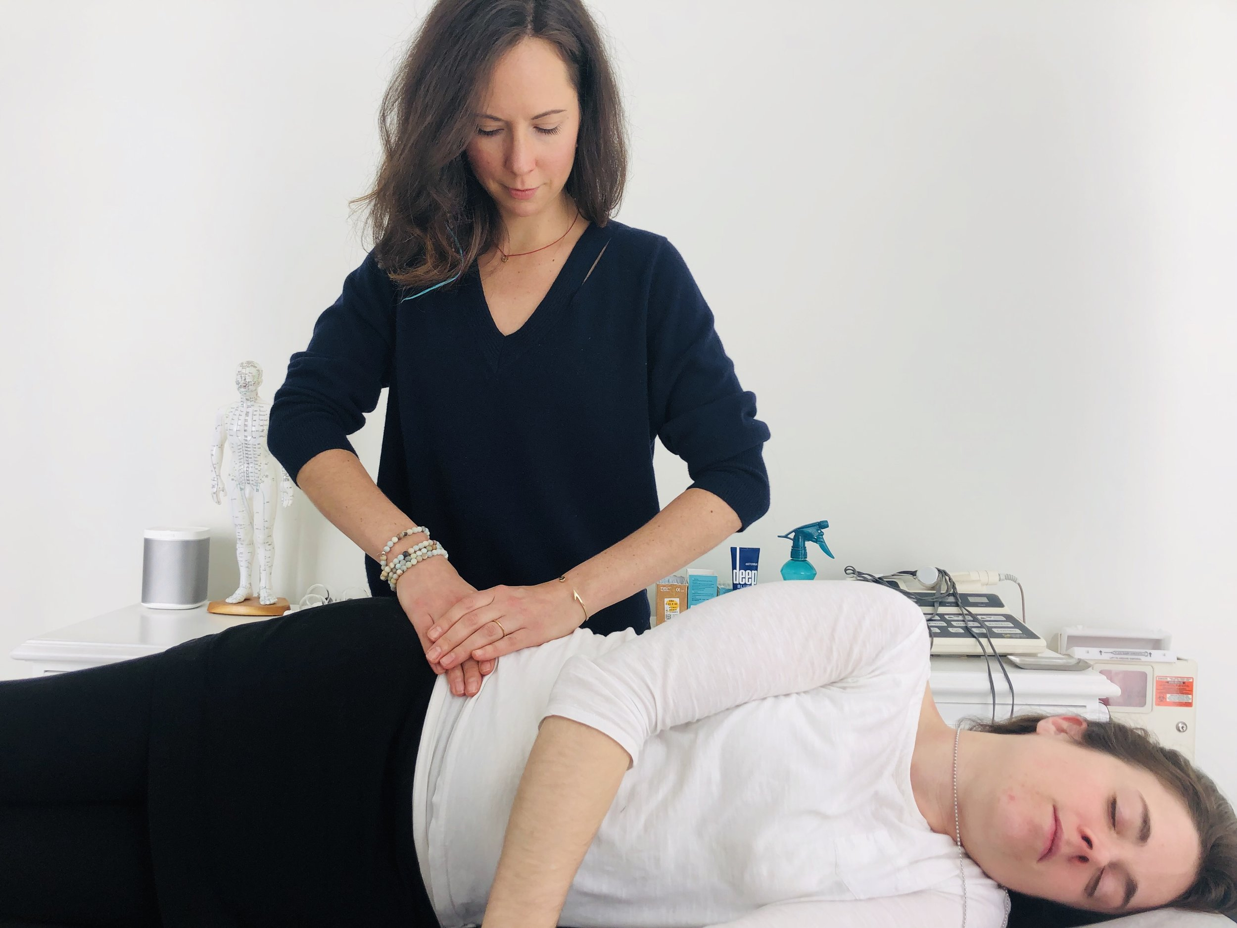 Dr. Jaclyn Amaro, Centered Chicago. Administering Active Release Technique.