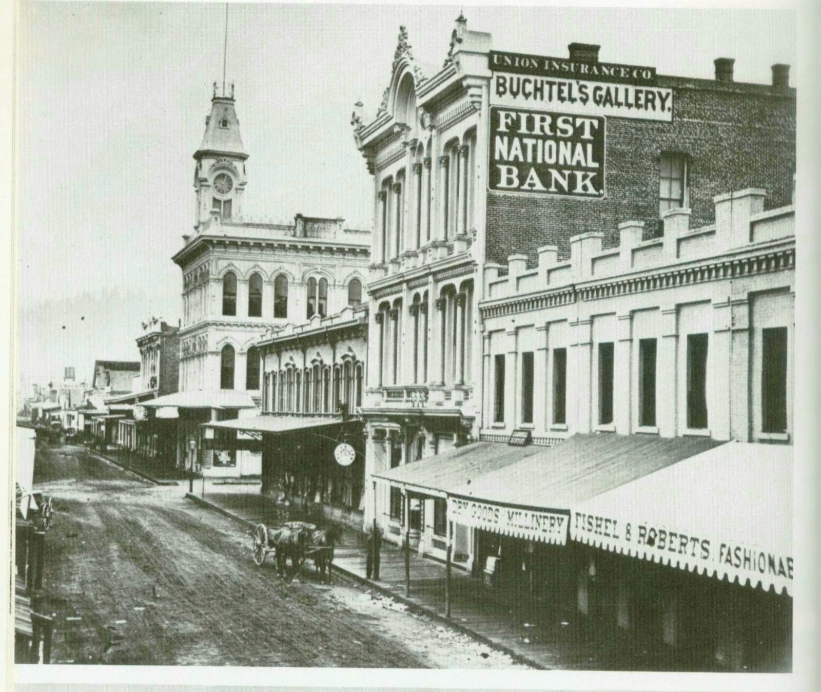First Street before the fires of 1872 and 1873. Note the Buchtel Gallery where Simeon Small was allowed to use the darkroom in the aftermath of the fire.  Courtesy   Cafe Unknown .