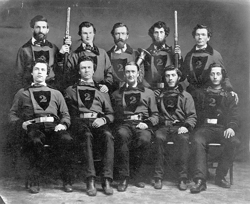 """Multnomah Company #2 in 1858.  Stephen  Skidmore , aged 19, is in the front row, left. When he joined the Red Shirts in 1857, it was a sign that he had """"arrived"""" in society.  Courtesy  Oregon History Project."""