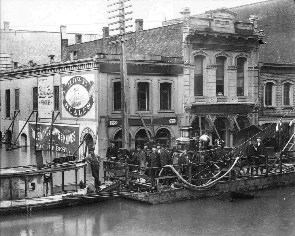 The Hallock-McMillan Building not only survived the Great Conflagration of 1873 but the floods of 1894. It is the building on the right.  Photo found on Pinterest