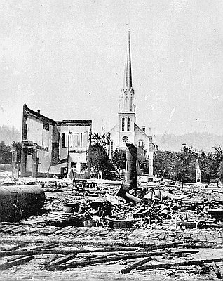 The photographer of this scene of the fire's aftermath is unknown. In  Burying My Dead , I attribute it to Simeon Small.  Courtesy   Oregon History Project.