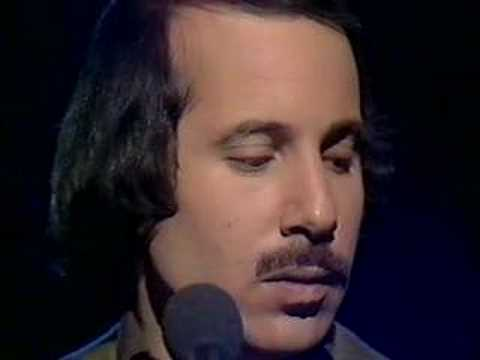 Singer Paul Simon playing  American Tune  in 1975, another tumultuous time. Click  here  to listen.