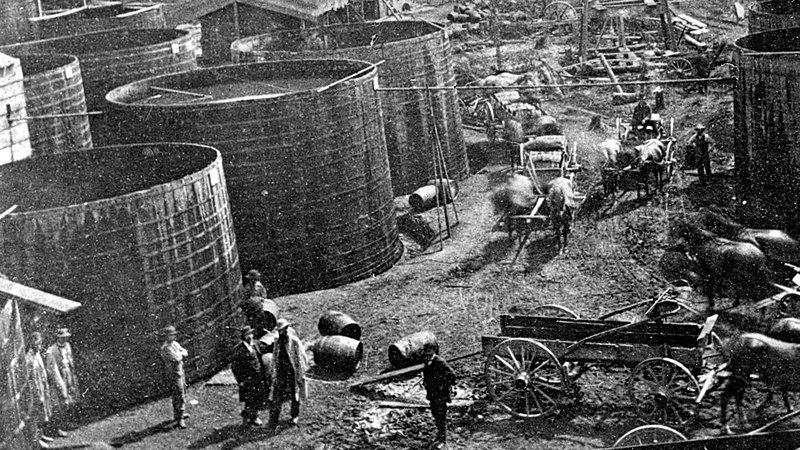 Holding tanks in Pithole, just before Samuel Van Syckel built the first oil pipeline linking the Frazier well to the railroad station five miles away.  Photo courtesy   Drake Well Museum   .  More info at   American Oil & Gas Historical Society.