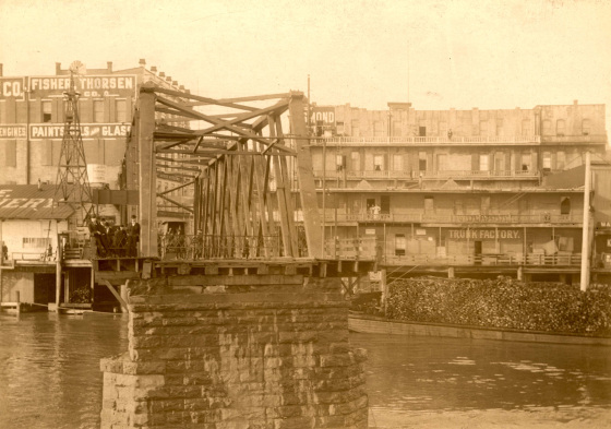 1900 view from the west side, when the bridge actually terminated at Morrison St. On the left is the 1887 Jennings Furniture Store; at right, the once elegant Esmond Hotel.  Photo courtesy    Vintage Portland     and PARC