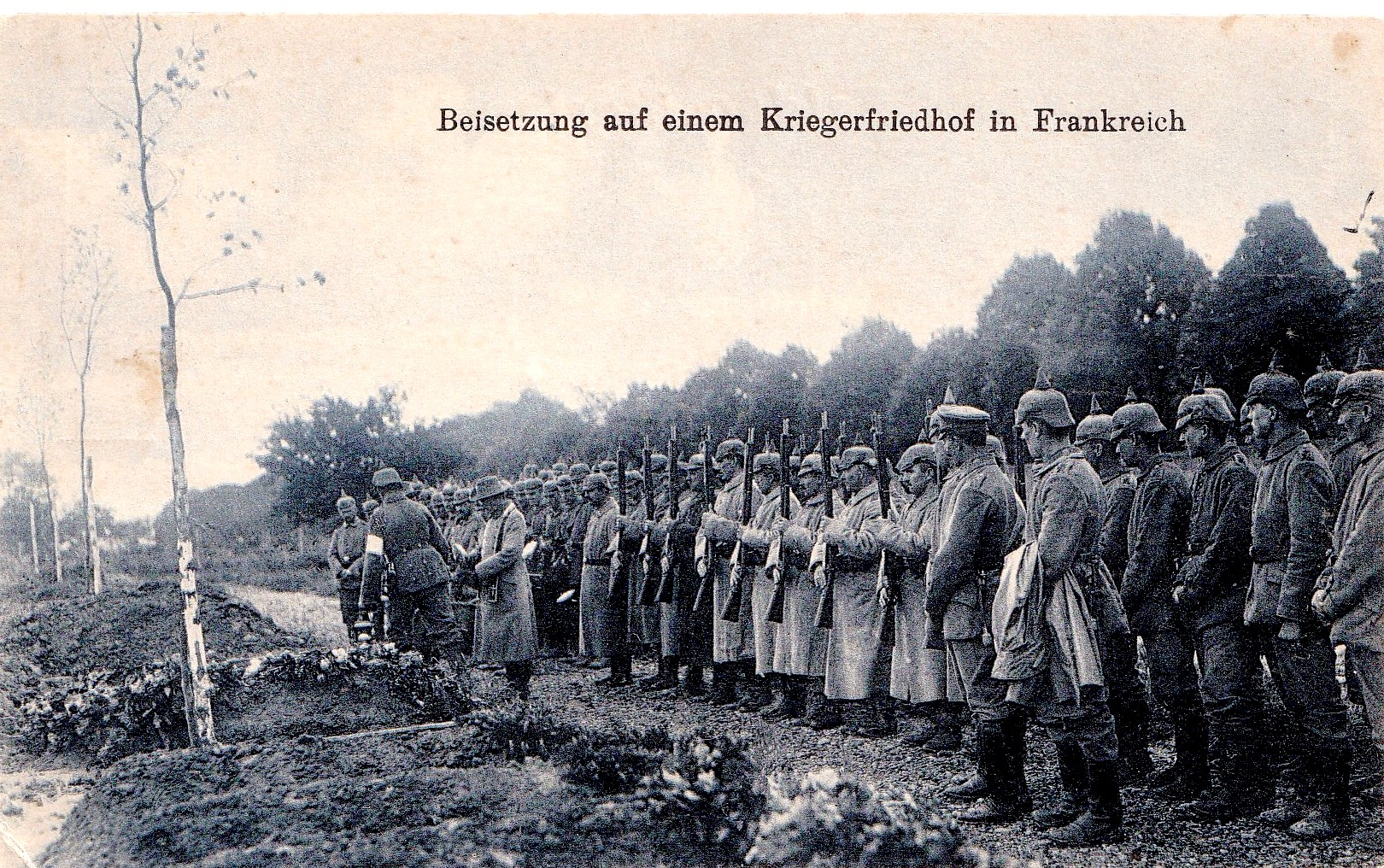 BURIAL AT A WAR CEMETERY IN FRANCE: in 1916, my mother received this postcard of German soldiers burying their dead on foreign soil.