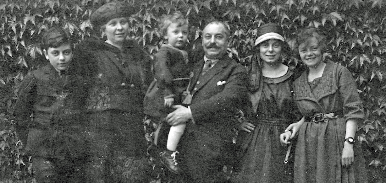 """Elsa was monitored at a local hospital for a few months while arrangements were made for an extended stay at a sanatorium. Her family came to visit.  From left to right, brother Günter, Mama, Papa holding """"Bubby"""" (Joe), sister Erika, and Elsa."""