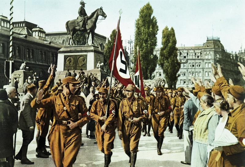 "The SA or ""brownshirts"" helped bring Hitler to power. The brown-colored shirts were chosen simply because they were available and cheap – left over from the troops posted to Germany's African colonies, all lost following World War I."