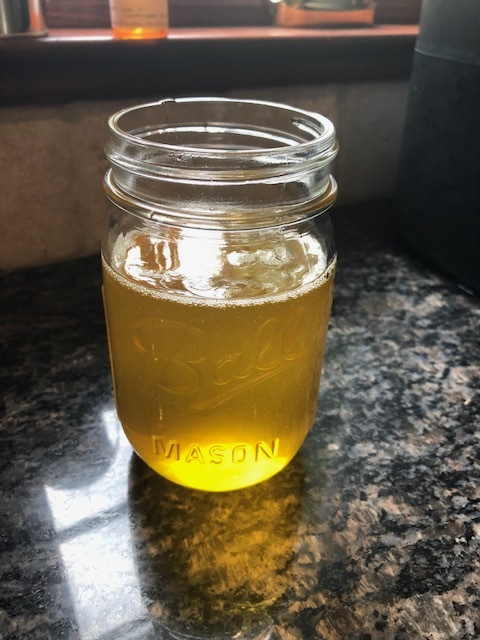 finished ghee in ball glass jar.jpg