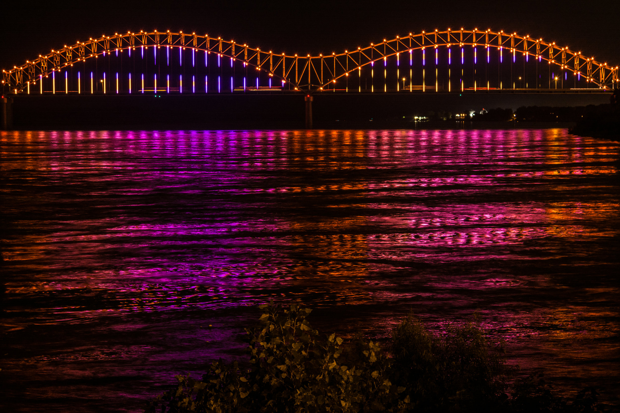 "Because of its massive size and scope - the ""M"" bridge surface area equals other robust Philips Lighting installations such as San Francisco's Bay Bridge.The lights can introduce millions of colors and pattern designs. They are synchronized and coordinated to achieve dramatic effects. The lights on Big River Crossing have introduced physical connectivity between Downtown Memphis and Arkansas, and the enhanced Hernando de Soto bridge lights visually connect Memphis' mile-long riverfront. (The lights are directed outward from the roadways, however, so drivers on the de Soto Bridge are not affected.)Memphis Bridge Lighting Inc. is committed to not only a successful lighting installation, but also a proactive sustainability effort. Mighty Lights recognizes special occasions through custom cause or corporate colors, and builds partnerships with Downtown stakeholders and institutions whose own narratives can add value and voice to our mission."