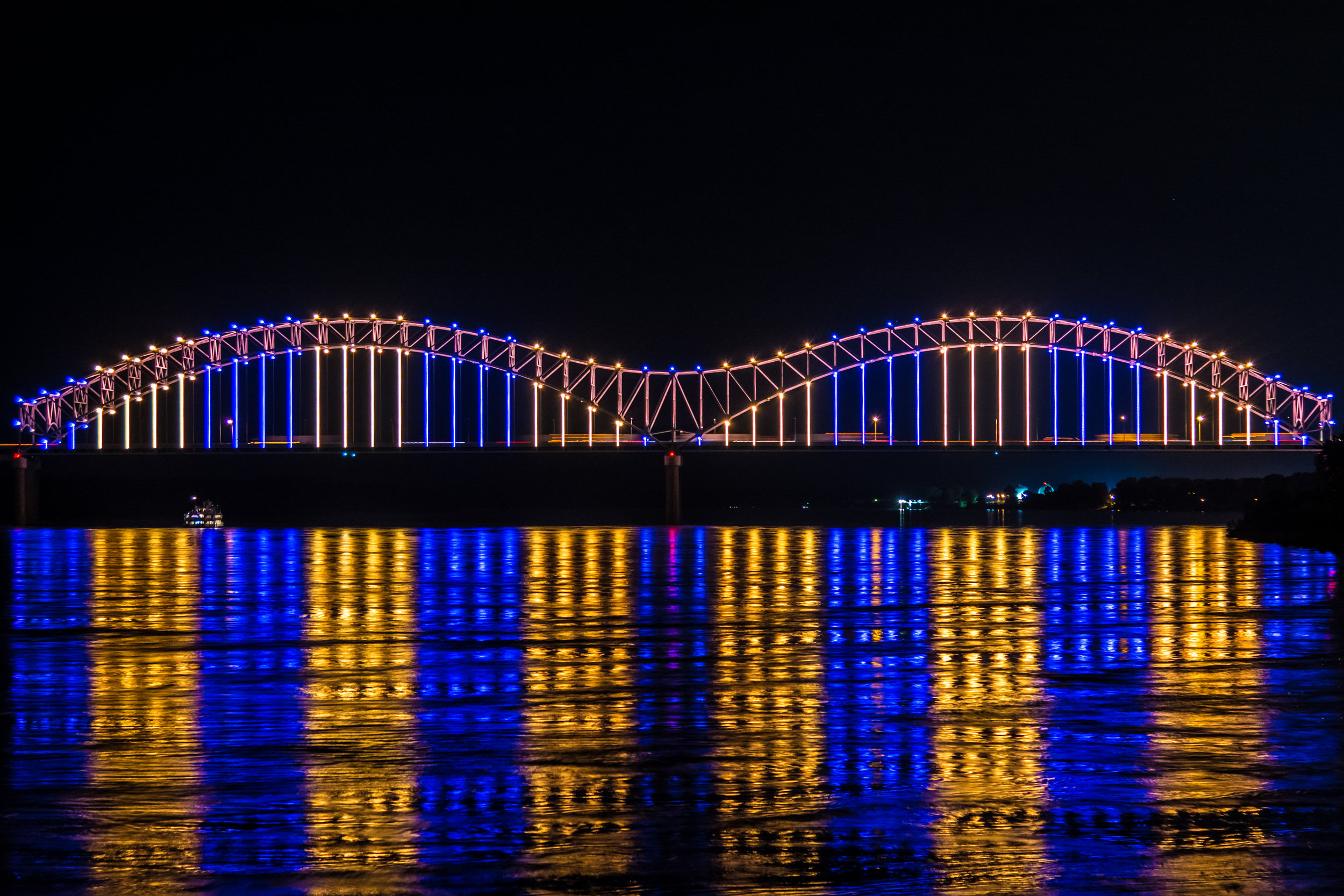 Hernando de Soto Bridge - Opened in 1973 and illuminated with its original bulb lights on September 5, 1986 by visionary local philanthropists, the Hernando De Soto Bridge has represented the iconic marquee of Memphis' riverfront for decades and has been used countless times in nonprofit, corporate, and tourism promotions.