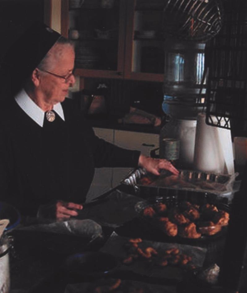 Sister Brigid baking cream puffs for St. Martin's Day